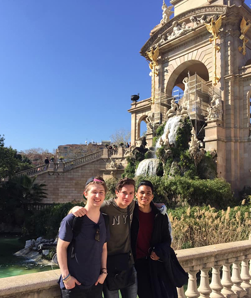 An image of three young men standing in front of a monument in Andorra.