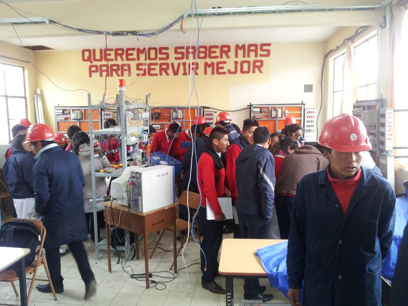 An image of several people in Bolivia learning about trades training.