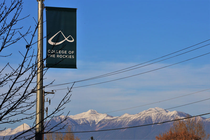 Image shows College of the Rockies banner with mountains in the background.