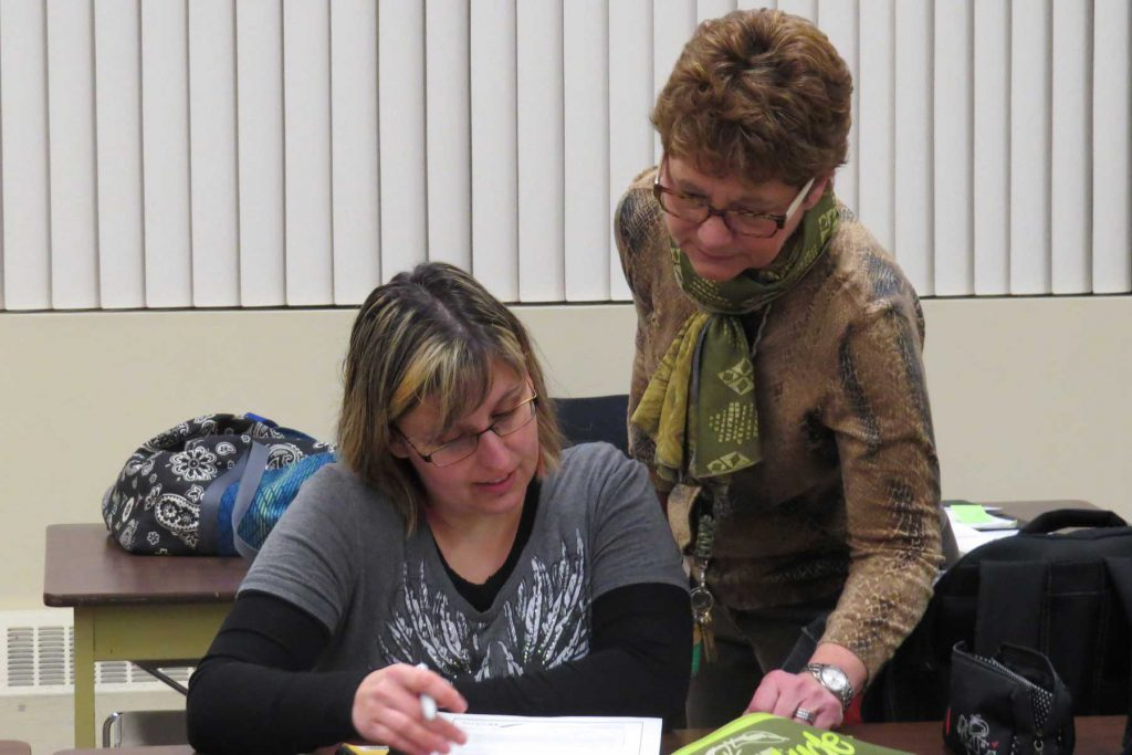 An image of an adult learner and her instructor.