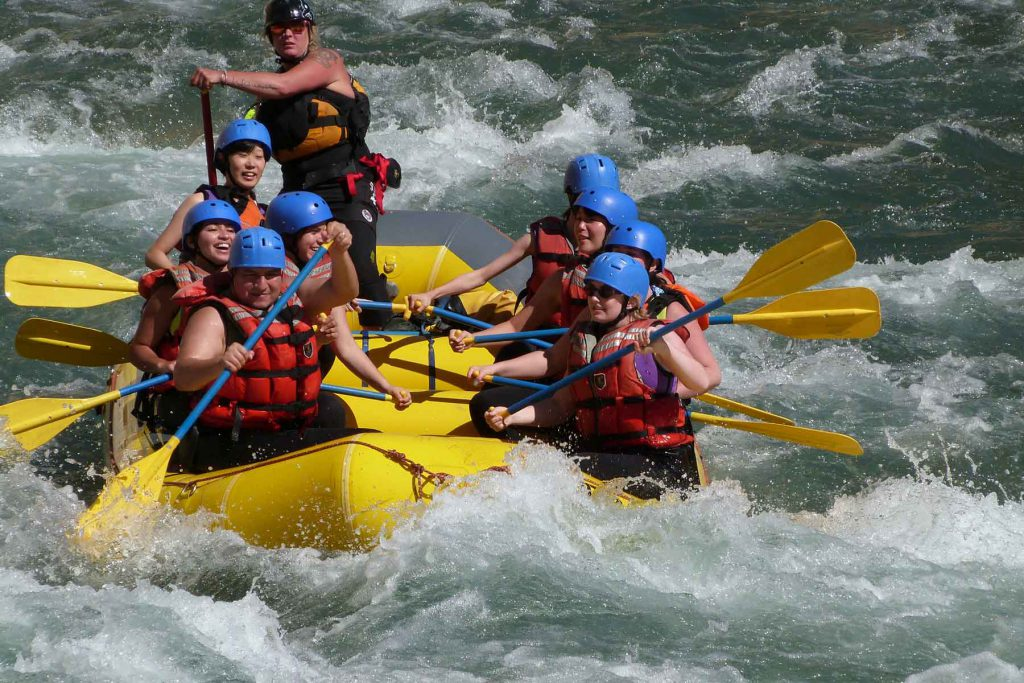 An image of several students white river rafting.