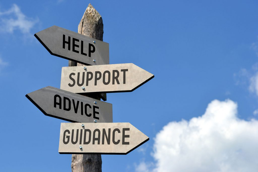 an image of a sign with markers pointing to help, support, guidance and advice.
