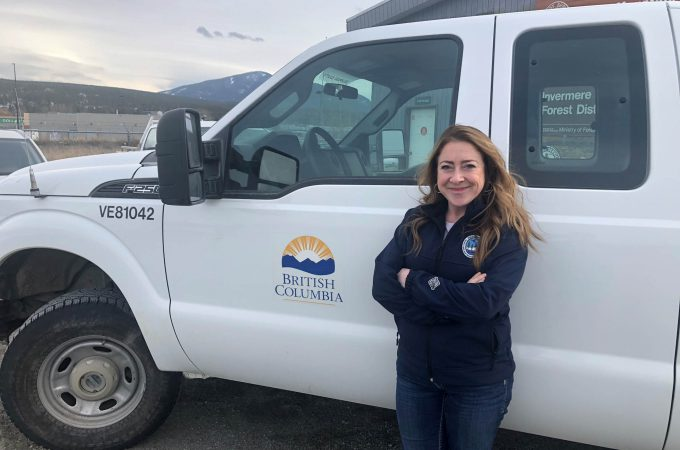 Image of woman standing in front of a Province of BC work truck