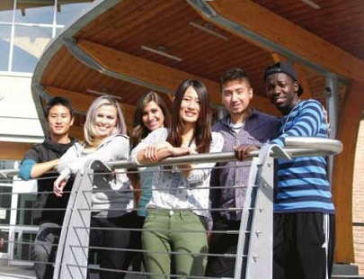 An image of international students near the college entrance.