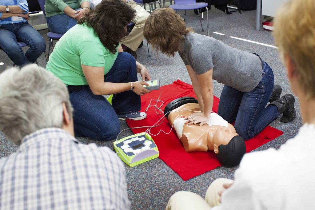 An image of a student practicing CPR.